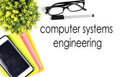 VIEW FROM THE TOP, TABLE WORKING WITH TEXT `COMPUTER SYSTEMS ENGINEERING` Stock Photos