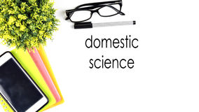 VIEW FROM THE TOP, TABLE WORKING WITH TEXT `DOMESTIC SCIENCE` Royalty Free Stock Photos