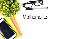 VIEW FROM THE TOP, TABLE WORKING WITH TEXT `MATHEMATICS` Stock Photography