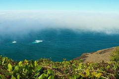 View from the top to the beach of the Pacific Ocean on a foggy morning stock photo