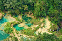 View from the top to the cascades in the jungles of Guatemala Royalty Free Stock Photography