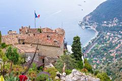 View from top to village buildings, tourists walking and sea royalty free stock images