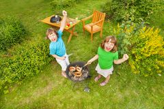 View from top of two sisters grilling BBQ meat Stock Photos