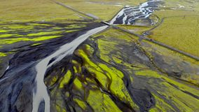 Aerial view of the direction of glacial rivers, Iceland. The view from the top the water flows down from the melting glacier forming a river Delta, Iceland stock footage