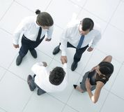 View from the top.welcome colleagues shaking hands in office. Lobby.photo with copy space stock photography