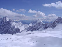 View from the top of Zugspitze. Mountain with glacier and ski resort in Bavarian Alps Stock Photo