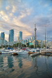 View of Toronto harbour front. Waterfront community of Toronto, Canada - May 16, 2015: Boats and yachts anchored at waterfront docks in downtown Toronto Royalty Free Stock Image
