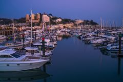 View of Torquay harbor at dusk, South Devon, UK. TORQUAY, DEVON UK - OCTOBER 14, 2017: View of the harbor in Torquay. Torquay, a seaside town in Devon, also Royalty Free Stock Photography
