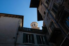 The view at Torre dei Lamberti from a street, Verona, Italy - Image stock photos