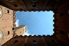 View of Torre del Mangia from courtyard of Palazzo Pubblico Stock Images