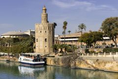 View of the Torre del Oro of Seville on the Guadalquivir River. Seville, Spain, March 03, 2019 royalty free stock images