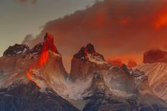 View of Torres Mountains in the Torres del Peine National Park during sunrise. Autumn in Patagonia, the Chilean side.  Stock Photo