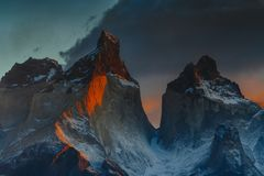 View of Torres Mountains in the Torres del Peine National Park during sunrise. Autumn in Patagonia, the Chilean side.  Stock Photography