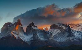 View of Torres Mountains in the Torres del Peine National Park during sunrise. Autumn in Patagonia, the Chilean side.  Stock Photos