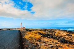 Lighthouse on the seawall Stock Photography