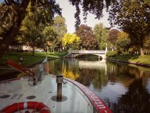 View from a tour boat on the park along the outer moats of Utrecht. Fall season in Utrecht, the Netherlands. Autumn colors on the outer moats Royalty Free Stock Images