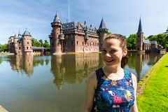 View of a tourist girl in the gardens of the De Haar Castle royalty free stock image