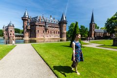 View of a tourist girl in the gardens of the De Haar Castle royalty free stock photography