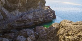 View of the tourist trail along the rocks and the black sea coast of Crimea.  Royalty Free Stock Photos