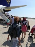 View of tourists embarking on a airplane. Outdoors sky blue stock photo