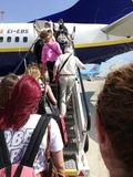View of tourists embarking on a airplane. Travel sky blue royalty free stock images