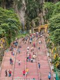Tourists Walk up Stairs to Batu Caves in Malaysia. View of When Tourists walk up stairs to Batu Caves in Malaysia Royalty Free Stock Image