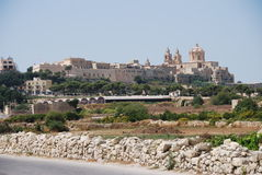 View Toward Mdina. A view from the Maltese countryside looking toward the fortress town of Mdina Royalty Free Stock Images