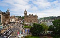 View towards Balmoral Hotel in Edinburgh. Edinburg, United States of America - June 14, 2014. View down Princes St in Edinburg, with historic building Royalty Free Stock Photo