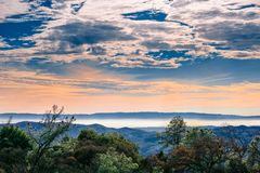 View towards the bay shoreline from Mt Diablo State Park. Colorful horizon light and amazing cloudscape; Contra Costa county, San Francisco bay area Stock Photography