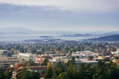 View towards Berkeley and Richmond on a sunny but hazy autumn day. University of California campus buildings in the foreground, San Francisco bay area Stock Photos