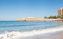 The View Towards the Castle of Santa Catalina. The view across La Caleta beach towards the castle of Santa Catalina in Cadiz, Spain Stock Image