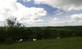 View towards Cornwall. From Dartmoor National Park in Devon on a bright day with large clouds royalty free stock photo
