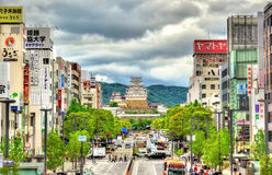 View towards Himeji Castle from the train station. Stock Photos