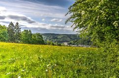 View towards Malmedy. View across a grass field towards the town of Malmedy in the Ardennes, Belgium Stock Photography