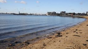 View towards Poole harbour and quay Dorset England UK with sea lapping stock footage