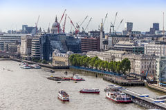 View from Tower Bridge of the north bank of the Thames River with construction cranes Royalty Free Stock Image