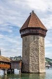 View of the Tower of the Chapel Bridge over the Reuss River in Lucerne, Switzerland stock image