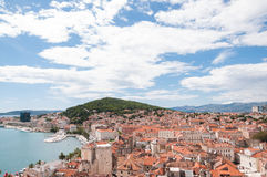 View from the tower in Diocletian's Palace, Split, Croatia. Beautiful view of the old city of Split and the yacht harbour, on a day with blue sky and white Royalty Free Stock Images