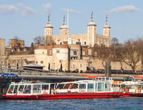Tower of London and River Cruise Boats Stock Image