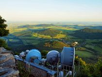 View from tower of meteorological observatory with many parabolic satellites to morning countryside. Spring morning. On the peak of hill royalty free stock photos