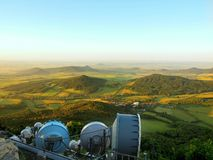 View from tower of meteorological observatory with many parabolic satellites to morning countryside. Spring morning. On the peak of hill royalty free stock images