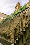 View on the tower in Pitigliano over the tuf wall and stairs Stock Images