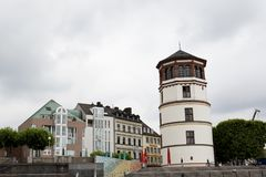 View at a tower and several houses at the rhine riverbank in düsseldorf germany stock photo