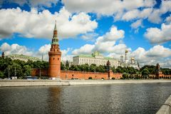 View of the towers of the Moscow Kremlin from the embankment of the Moscow river on the background of beautiful blue sky with clou Royalty Free Stock Photography