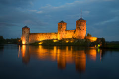 View of the towers of the Olavinlinna fortress in the august twilight. Savonlinna Royalty Free Stock Photography
