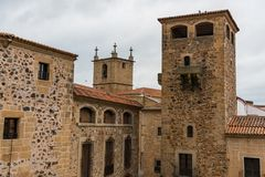 View of the towers and stone buildings of the old town from the Plaza de San Jorge in Caceres. royalty free stock photo
