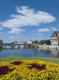 View of town and bridge spanning river on sunny day, Jarnac and the Charente river, West Central France Stock Photo