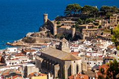 View of the town and castle of Tossa de mar one of the most beautiful towns on the Costa Brava. City walls and medieval castle on the hill. Amazing city in stock photos