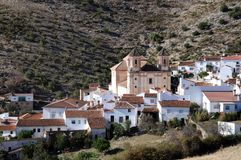 View of town and church, Alpandeire. View of the town and church, Alpandeire, Serrania de Ronda, Malaga Province, Andalusia, Spain, Western Europe Royalty Free Stock Image