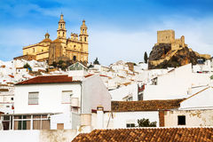 View of  town with church and  castle. Olvera, Spain Royalty Free Stock Photography